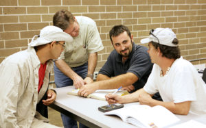 A group of adult education students studying together.